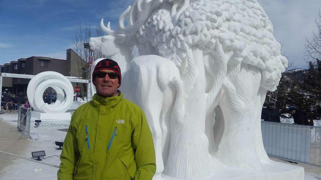 Peter standing next to snow sculpture