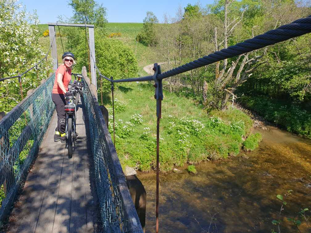A narrow foot bridge in Speyside