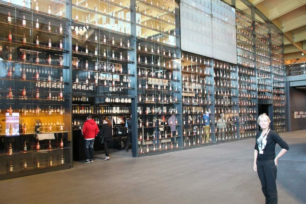A wall of whisky, a bottle from every year in the Macallan Distillery