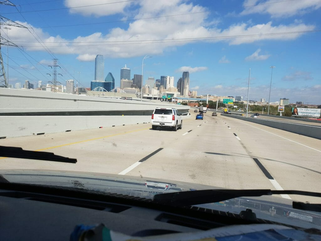 View out of the windscreen as we drive into Austin.