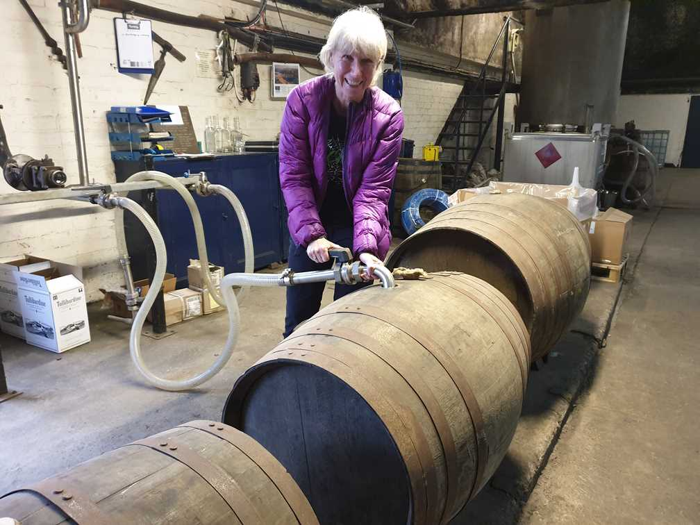 Me filling the whisky barrel with whisky