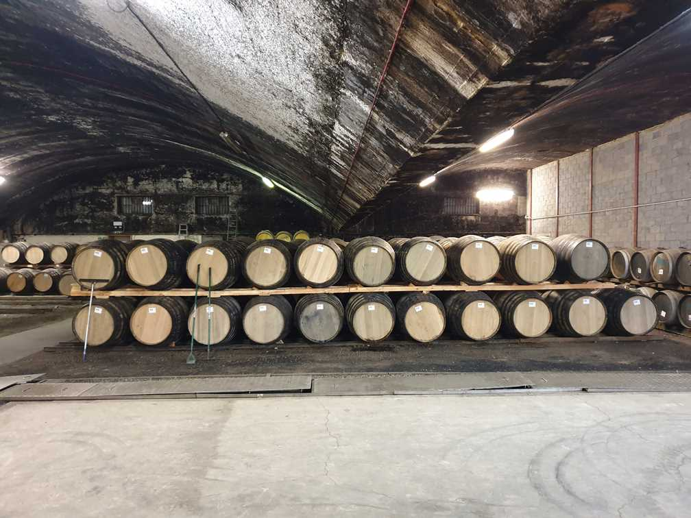 Barrels piled up in the warehouse at the whisky distillery