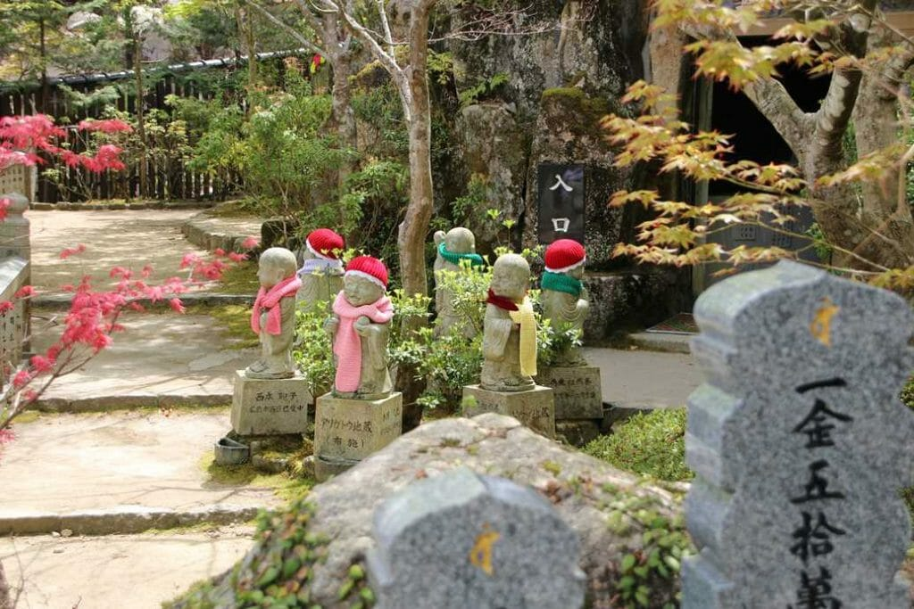 Jizo figures in hats and scarves