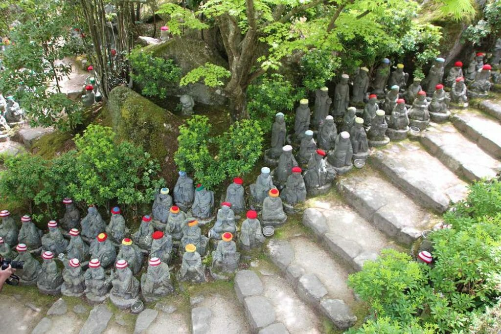 Jizo figures wearing hats and scarves