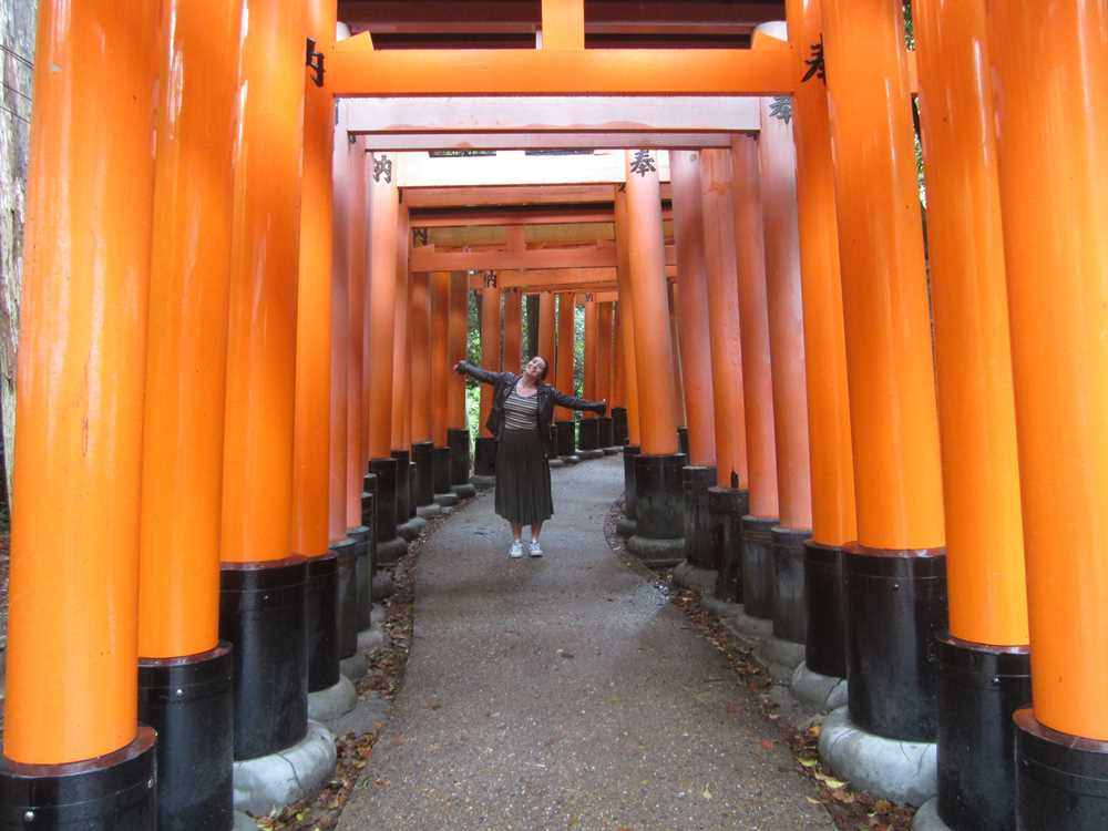Beth in the red torii gates of the shrine