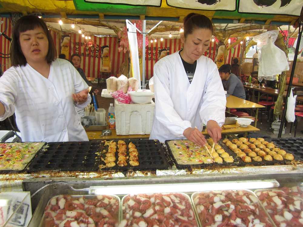 Making tokiyaki at street food stall