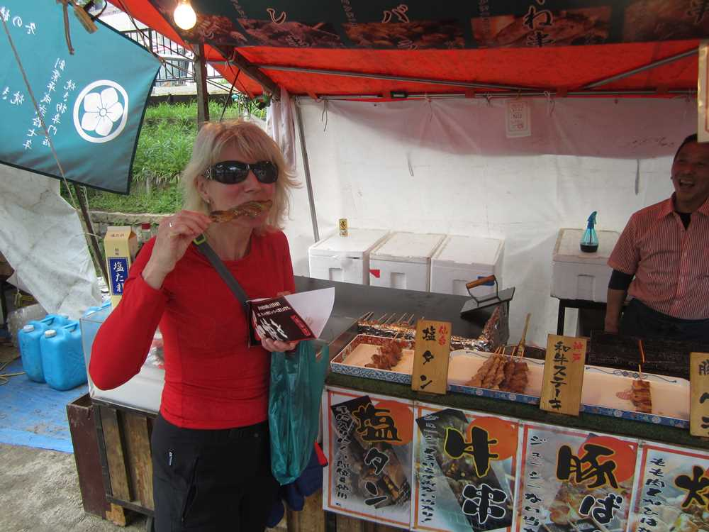 Jane eating street food on Osaka