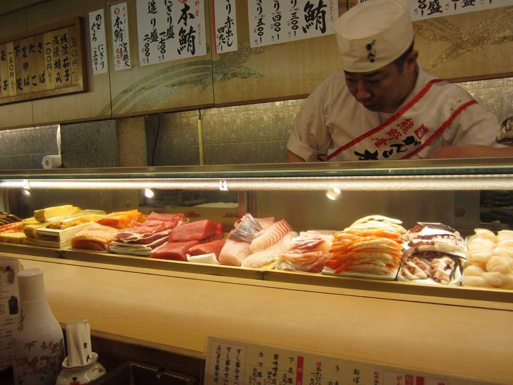 Chef preparing dinner in seafood restaurant