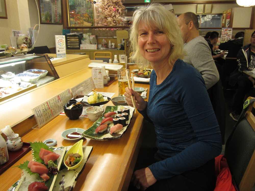 Jane with Sushi and Sashimi meal
