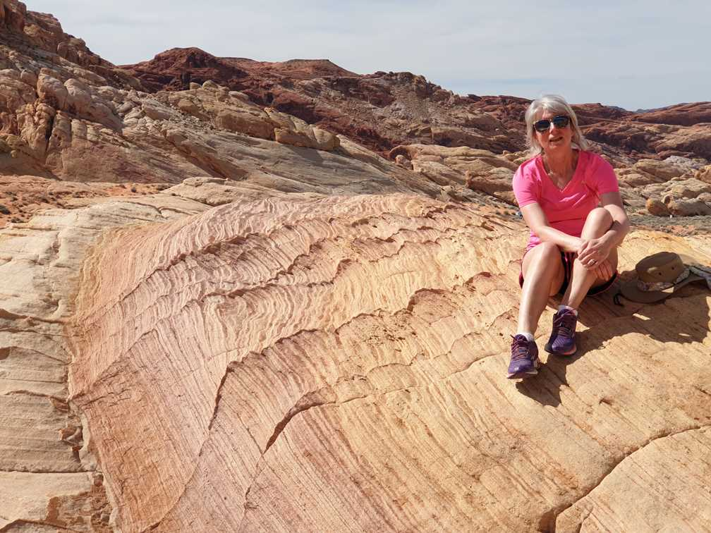 Sitting on rock on hike in Valley of Fire