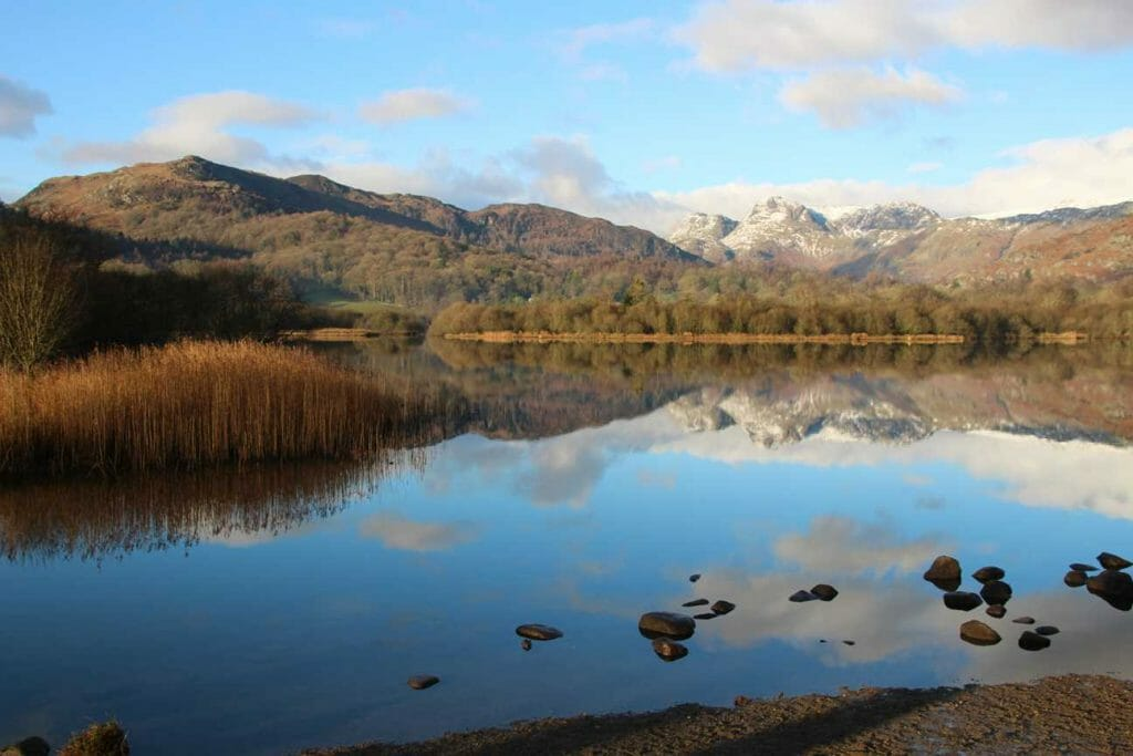 Reflection on Elter Water with view over Langdales