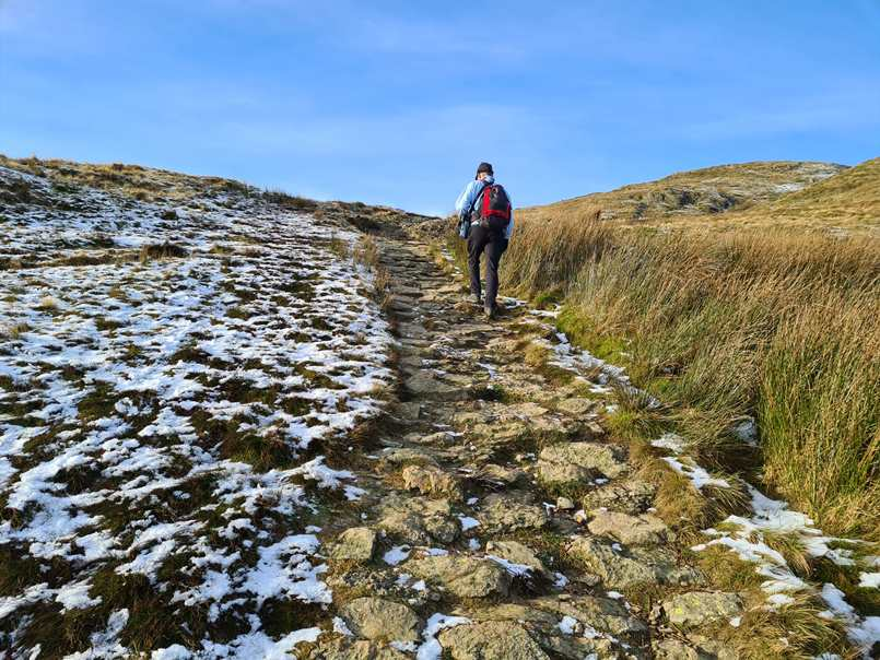The trail up Wansfell Pike paved with stones in places