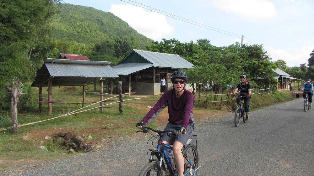 Jane on bike on Cambodia by bike trip