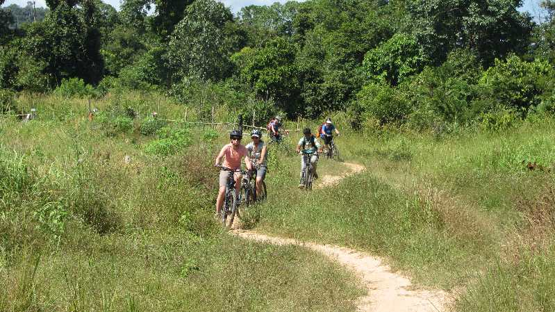 Cycling along dirt track on Cambodia by bike
